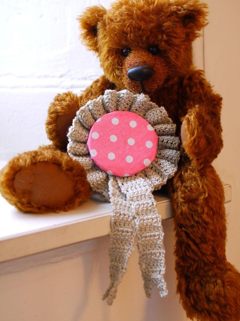 Teddy-w-ros,-holding-it