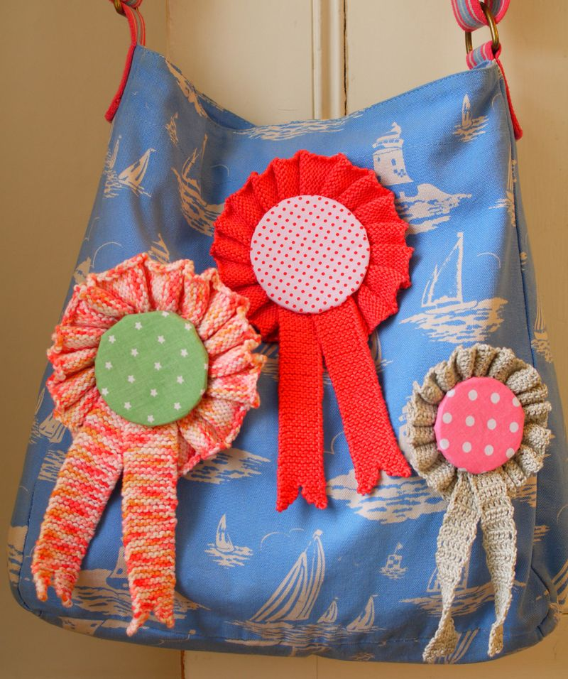 Close-of-bag-w-3-rosettes,-