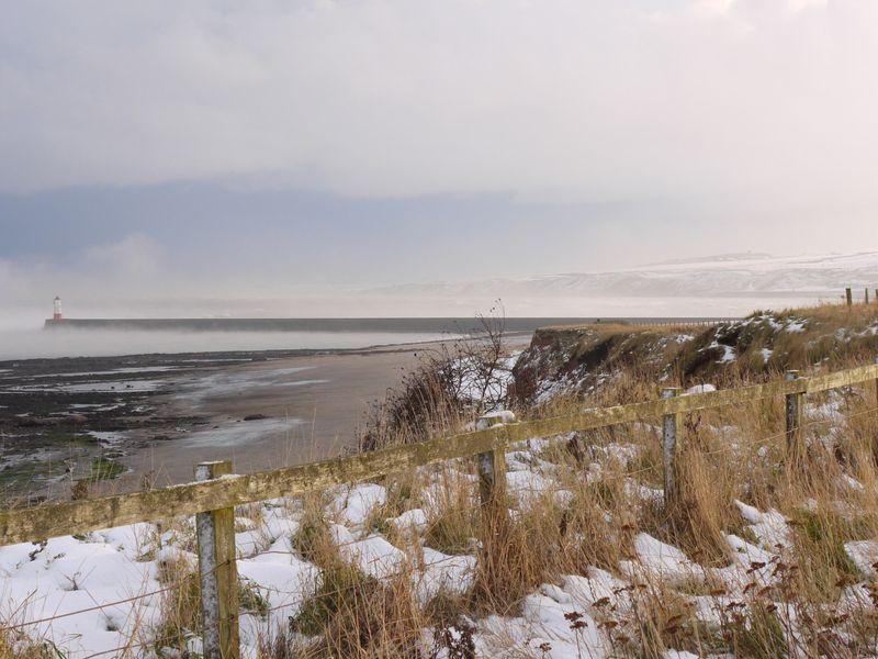 Snow,-cliff,-lighthouse